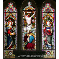 St Catherine, Wickford Church - The East window depicts Jesus on the cross, flanked by Saints. It is in memory of Henry Stone, churchwarden during the rebuilding of the church. It was recently (1998) restored.