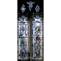 St Mary, Broxted Church - One of two two-light 'hostage' windows by John Clark. This 
