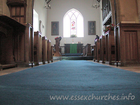 St Giles, Mountnessing Church - Looking through the nave towards the chancel.