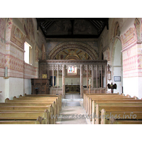 St Michael & All Angels, Copford Church - Looking towards the chancel, from the W end of the nave. Clearly visible here are four springers, which once supported the Norman barrel vaulting. Two can be seen either side of the screen, whilst the other two are clearly visible at both upper corners of the image.